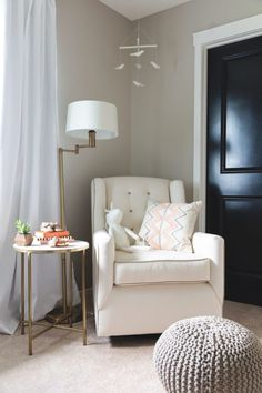 Neutral Nursery of Gold, White, Black, Grey and Pops of Corals