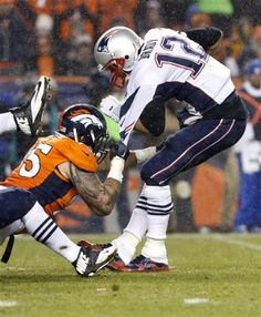 New England Patriots quarterback Tom Brady (12) is sacked by Denver Broncos defensive end Derek Wolfe (95) during the first half of an NFL football game, Sunday, Nov. 29, 2015, in Denver.