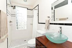 bathroom with glass tiles in shower