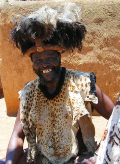 Zulu King in ceremonial dress welcoming visitors to his village in Kwa Zulu Natal in South Africa
