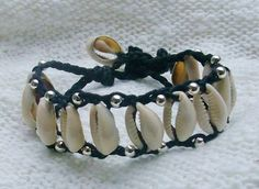 Cowry shell bracelet and silver beads on braided cotton thread