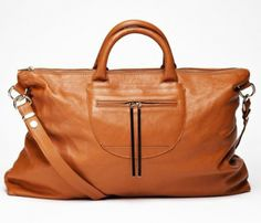 Caramel weekender bag: love the pop of color inside!
