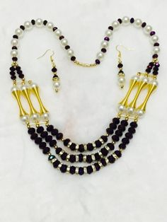Elegant Pearl Necklace with Black and Golden Beads