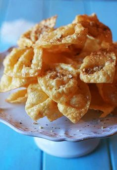 """""""Diples"""" - Greek traditional crispy, festive bow ties with honey and walnuts"""