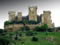 CASTLES OF SPAIN - Castillo de Almodóvar del Río is a castle of Muslim origin in the town of Almodóvar del Río. It is situated 15 miles (24 km) from Córdoba, on the left bank of the river Guadalquivir. Previously a Roman fort, the current structure has Berber origins, in the year 760. During the Middle Ages, it underwent several renovations and reconstructions. Between 1901 and 1936, it was restored by the owner Raphael Desmaissiers, 12th Count of Torravala.