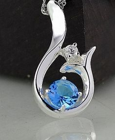 14K WHITE GOLD FILLED PENDANT WITH A GORGEOUS BLUE TOPAZ    FREE SHIPPING