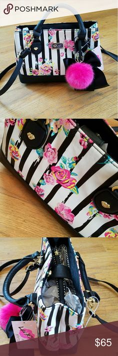 """🌹NWT-BETSEY JOHNSON BEAUTIFUL FLORAL DESIGN! 🌹NWT-BETSEY JOHNSON FLORAL DESIGN PURSE BEAUTIFUL BAG OFFERS SO MANY UNIQUE OPTIONS WITH THE KISS SHAPES ITS BIG PINK PUFF BALL AND BLACK BOW PLUS A STRAP AND HANDLES JUST A PERFECT PURSE FROM BETSEY! YOU WILL ABSOLUTELY LOVE IT.😍 SIZE:  8""""L X 12""""W   🌹NWT-BRAND NEW WITH TAGS 🌹100% AUTHENTIC 🌹SAME DAY SHIPPING 🌹NO TRADES  🚨CLOSET RULES POSTED PLEASE READ AND FOLLOW NO RUDE COMMENTS! PLEASE BE RESPECTFUL TOWARDS ONE ANOTHER😊 Betsey Johnson…"""
