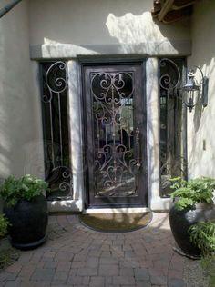 This will be my kitchen pantry door someday! Ornamental iron door interior.