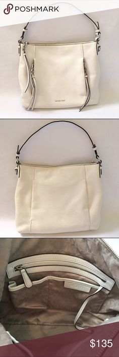"""Michael Kors Corinne Handbag White Leather Beautiful Michael Kors """"Corinne"""" Purse in White. Beautiful pebble leather. Top zip closure. 3 open pockets, cell phone pocket, zip pocket and key chain inside. Comes with shoulder strap as well. Measures  approx. 14"""" x 12"""" x 4"""". Excellent used condition with a few minor things to note. Very small spot on the top zipper. Small pen mark on the back of the bag. Retail $378. Michael Kors Bags Shoulder Bags"""