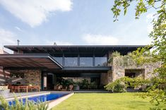 Contemporary brick architecture is combined with traditional style stone walls within the build of this house located in Zapopan, Jalisco, Mexico. Put together