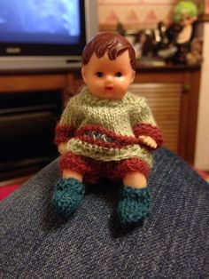 Tiny rubber doll , I knit the outfit with 1ply on miniature pins