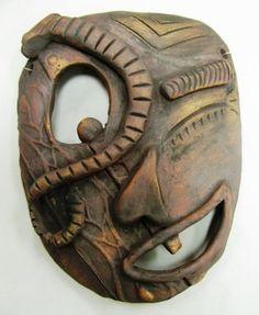 Outstanding high school ceramics - lots of great ideas - ARTISUN: Clay Masks - Student Work