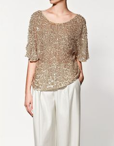 love the top but prefer it with fitted white pants.
