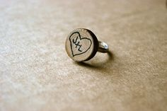 An interesting idea using wooden scraps or buttons. Hot glue onto a metal band and give as a precious gift.