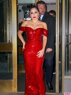 """Lady Gaga channels """"Who Framed Roger Rabbit"""" character, Jessica Rabbit, wearing a red sequin off-the-shoulder dress. The singer posed for pictures outside her hotel and showed off her curvy figure."""
