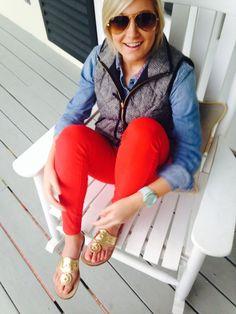 red pants, denim shirt, and vest
