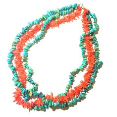 Turquoise & Coral Three Strand Necklace Turquoise & Coral Three Strand Necklace --- The coral is not natural. I'm not sure about the turquoise. A stunning necklace. I love these two colors together. 17 inch length. Very good condition. Thank you for visiting my closet Vintage Jewelry Necklaces