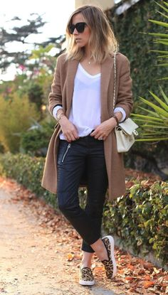 Consider wearing a brown coat and black leather skinny jeans to effortlessly deal with whatever this day throws at you. Want to go easy on the shoe front? Choose a pair of tan leopard slip-on sneakers for the day.  Shop this look for $497:  http://lookastic.com/women/looks/sunglasses-long-sleeve-t-shirt-slip-on-sneakers-skinny-jeans-crossbody-bag-coat/5906  — Black Sunglasses  — White Long Sleeve T-shirt  — Tan Leopard Slip-on Sneakers  — Black Leather Skinny Jeans  — Beige Quilted Leather…