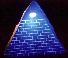 Glwoing pyramid with one eye