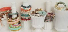 white painted bottles and vases for jewelry storage