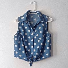 Short polka dotted shirt Small pocket on the front left Tops