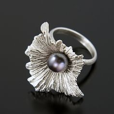 Aleksandra Vali's Modern Art Jewelry: The Solanum Ring is made from Sterling Silver with a Fresh Water Pearl by curving, casting, and fabrication. Ring sizes are adjustable.
