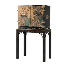 Description: A finely hand-painted and black lacquered cabinet on stand, the cabinet with gold leaf and hand-painted decoration of peacocks in a landscape, with fine repousse chased brass mounts, on a base with chamfered legs and fretwork spandrels hand- Luxury Furniture Brands, Quality Furniture, Furniture Care, Furniture Making, Furniture Design, Antique Bar, Theodore Alexander, Dining Room Bar, Traditional Furniture