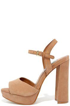 "Let the Steve Madden Kierra Camel Nubuck Leather Platform Heels take your look up a level ... literally! Soft nubuck suede upper forms a wide toe strap and buckling quarter strap. 0.75"" toe platform."