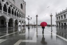 Woman with red umbrella in front of Doges palace with acqua alta (MR). Woman with red umbrella in front of Doges palace Wall Art by Matteo Colombo from Great BIG Canvas. Paris Photography, Travel Photography, Paris Wall Decor, Cannon Beach Oregon, Red Umbrella, Extra Large Wall Art, Red Art, Doge, Street View