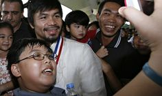 Supporters of congressman and world boxing champion Manny 'Pacman' Pacquiao take a photo with him in Manila. Photograph: Cheryl Ravelo/Reuters
