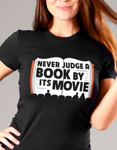 """""""Never Judge a Book By It's Movie.""""  Awesome t-shirt gift idea for book lovers and bookworms.  Funny tees for men and women."""