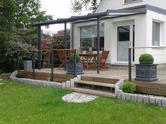 Holzterrasse, Granitpalisaden,Alu Terrassendach mit Milchglas