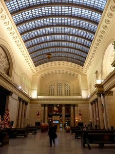 Chicago Union Station! Via Amtrak. I have sat in the hall and every time am amazed at the beauty. The beautiful worn marble stairs that millions of people have walked on. The gorgeous pews that have heard so many stories. A hallowed place for me.