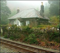 Station Master's Cottage next to the Ffestiniog railway in Wales. What a magical looking little home.