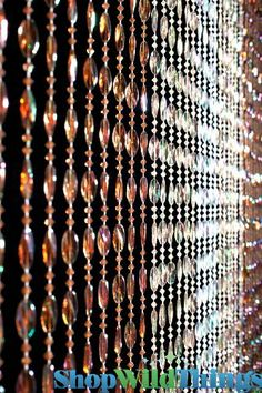 """Ice Pop Browns Beaded Curtain by ShopWildThings. $19.99. This curtain is great for those looking for a more neutral acrylic beaded curtain. The price is right too! This curtain is 35"""" x 70""""...has brown, cream, and crystal beads. There are 34 strands of beads. Like all of our door beads beaded curtains, this is pre-strung and hanging inside of one rod. Very nice and easy to put right up with 2 nails or hooks and 2 minutes of your time!"""