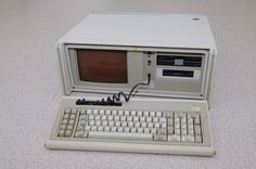 IBM Portable PC.  I remember lugging this thing home on the train. It was about 30 lbs and was the size of a sewing machine!
