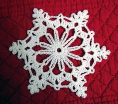 Crochet Flowers Pattern Ravelry: Chain Loop Snowflake pattern by Better Homes and Gardens Crochet Snowflake Pattern, Crochet Stars, Crochet Snowflakes, Crochet Flower Patterns, Thread Crochet, Crochet Motif, Crochet Crafts, Crochet Doilies, Crochet Projects