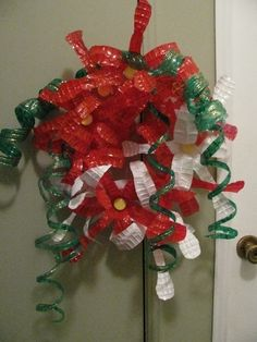Wreath made out of recycled water bottles recycled art for Christmas decorations from recycled plastic bottles