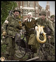 Two troopers of the Battalion, PIR celebrate the liberation of Veghel with a civilian outside of Saint Lambertus church in Veghel, on the afternoon of September 17 Military Photos, Military History, Operation Market Garden, 101st Airborne Division, War Image, Band Of Brothers, Paratrooper, American Soldiers, Vietnam War