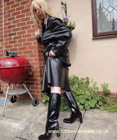 Raincoat and black rubber high heel boots