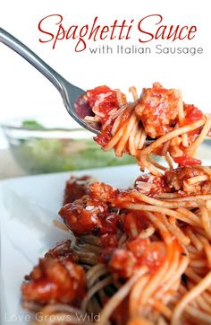 Spaghetti Sauce with Italian Sausage - I changed sauce to 28 oz dices tomatoes 28 oz crushed tomatoes 6 oz tomato paste cup red wine 5 cloves garlic tsp Kosher salt and NO water. Italian Sausage Spaghetti, Best Spaghetti Sauce, Spagetti Recipe, Italian Sausage Recipes, Sweet Italian Sausage, Spaghetti Sauce Recipe With Sausage, Italian Sausages, Sauce Recipes, Pork Recipes
