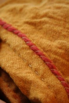 Here is the seam allowance folded down to one side, where after concealed edge of an madder dyed wool yarn . Provides a very strong seam!