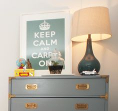 Love this campaign dresser !  Wonder what it looked like before it was painted - though that color is LOVELY.