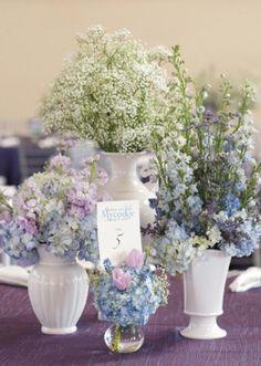 Pretty wedding centerpiece installation with garden florals in white vases designed by leFleur Couture.  Photography by Sara Donaldson.  #wedding #flowers #bride