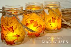 diy leaf mason jar candle holders - just mod podge real or fake leaves to the outside of a mason jar and tie some rafia around the top.