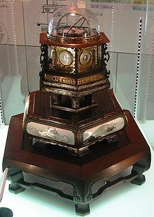 The Myriad year clock (万年自鳴鐘 Mannen Jimeishou?, lit. Ten-Thousand Year Self-ringing Bell), was a universal clock designed by the Japanese inventor Hisashige Tanaka in 1851. It belongs to the category of Japanese clocks called Wadokei. This clock is designated as an Important Cultural Asset by Japanese government... {contd. http://en.wikipedia.org/wiki/Myriad_year_clock }