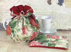 Tea Cozy  Bundle your beloved but chipped teapot prettily, insulating the brew that might otherwise cool during friendly conversation. Elasticised base with drawstring.