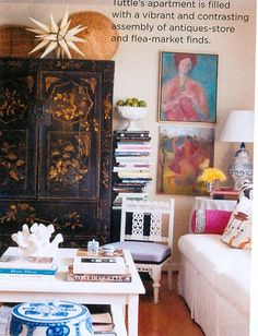 love the white base, blue, pink and yellow accents with the dark wood chinoiserie piece.