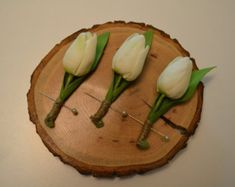 White Tulip Spring Boutonniere with Green Leaf and Wrapped with Twine