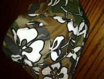 Sell one like this Super cute Like New Bucket Hat Green Camo with White Hawaiian type Flowers